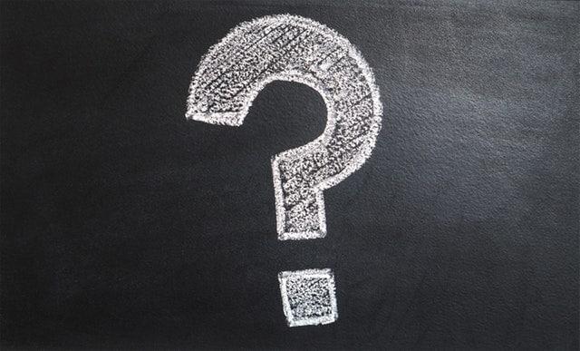 question mark written on a chalkboard with chalk