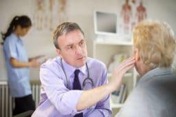 doctor looking into patients ear