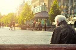 Elderly Man Sitting Alone on a Bench