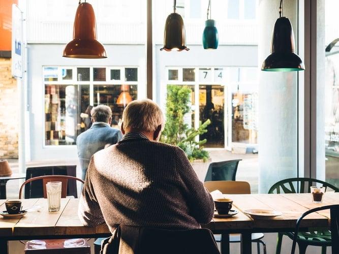 Man sitting inside coffee shop.